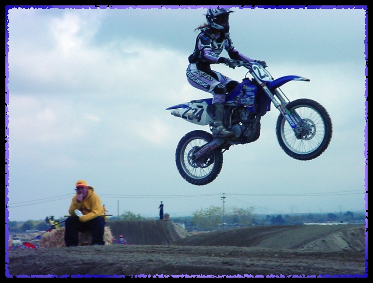 Alisa - flying dirt bikes at motocross race...